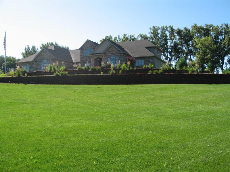 house with nice lawn & landscaping